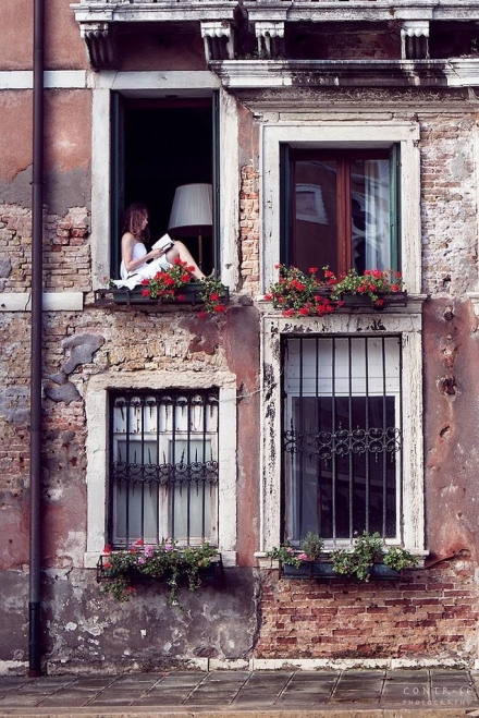 Woman in window Venice